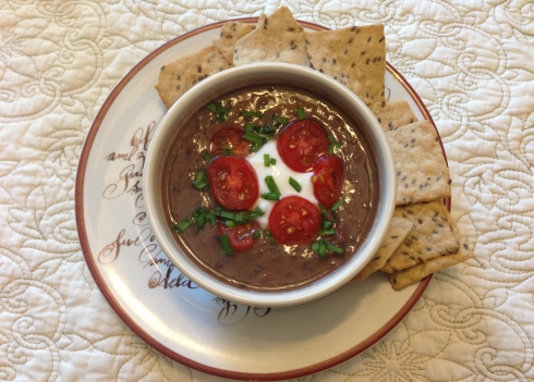 Delicious black bean soup topped with chopped grape tomatoes, plain yogurt, and fresh chives from my garden.