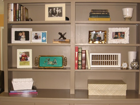 Books create balance, making the perfect backdrop for organizing pictures and other objects you wish to display.