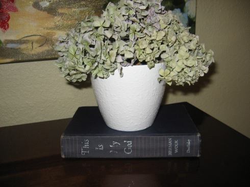 I purchased this book for $1. The hydrangeas are from my garden. I dried them and sealed them with acrylic clear coat. (I'll be providing details on how to do this in a near-future post). I already had the flower pot, but I painted it white and sealed it with a glossy clear coat.
